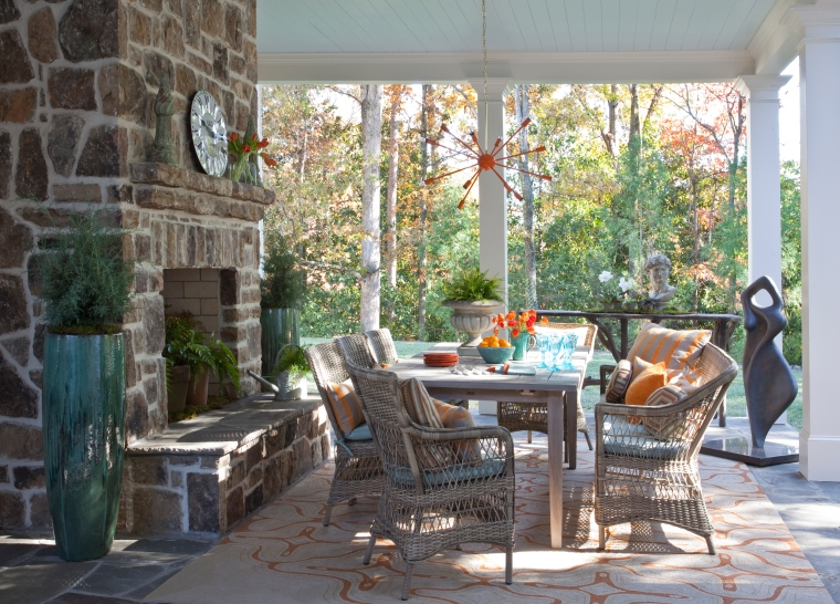 An outdoor dining room we designed for the Atlanta Homes & Lifestyles Show House- featuring Grange furniture and Sunbrella fabrics.