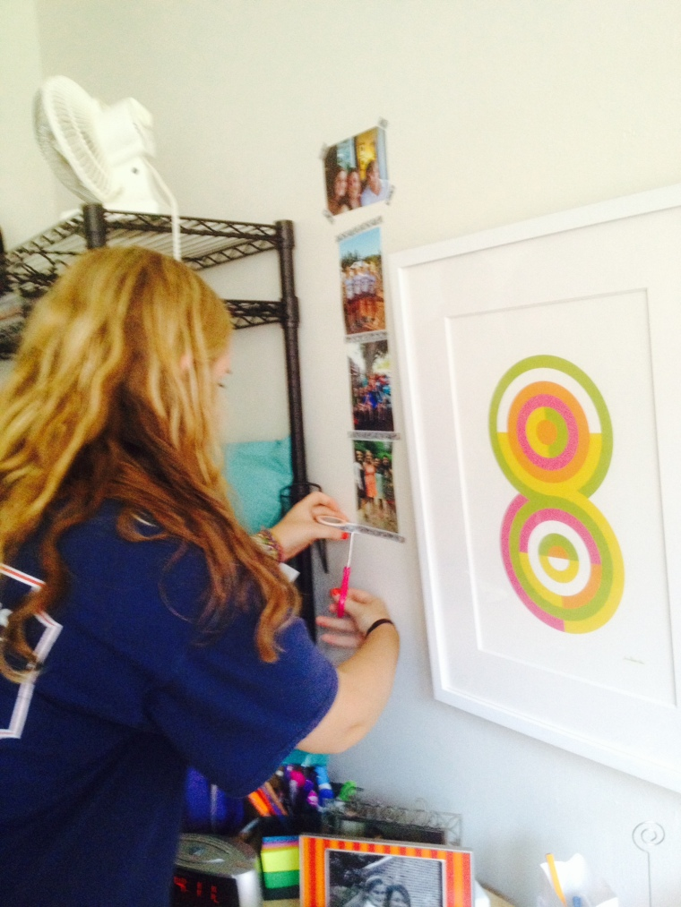 Mimi putting her personal touch on her new dorm room!