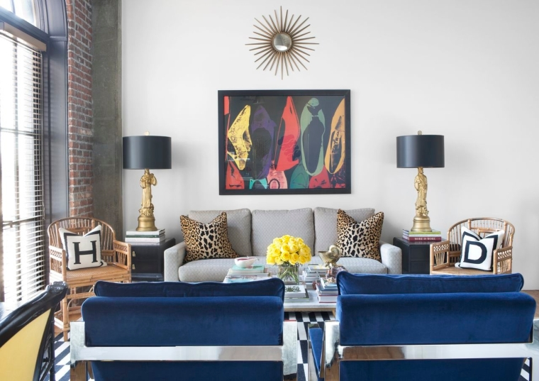 Condos can be a harder sell for magazines because there often isn't as much architectural charm, but interior designer Helen Davis's own loft has the advantage of brick walls and an arched window, plus her own swanky furnishings: a colorful mix of vintage, repurposed and personal accessories. Atlanta Magazine has covered her place, and it will also appear in BH&G's Refresh later this summer. Photography: Sarah Dorio