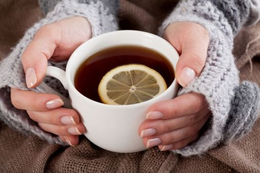 woman-holding-hot-tea-with-lemon.jpg.653x0_q80_crop-smart