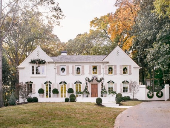 Breathtaking white brick French Country home decorated for Christmas